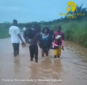 Travellers had to walk through the floodwater to get to thier destinations