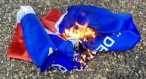 NPP supporters burn party flags and Apedwa